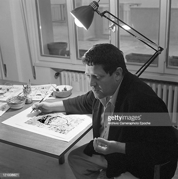 Italian illustrator Hugo Pratt portrayed while drawing a Corto Maltese board in his apartment Venice 1966