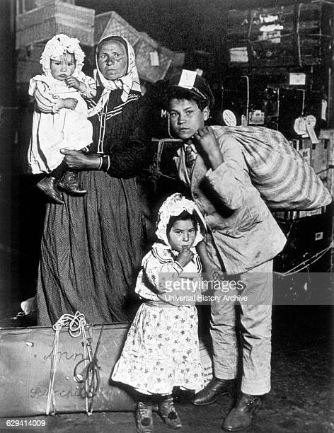 Italian immigrant Family, Ellis Island, New York, USA, May 1908. They are Anna Schiacchitano from Sicily and her children Paolo , Mary and Domenico ....