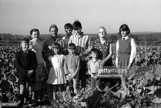 Italian immigrant Pietro Ceccato who came to Australia in 1949 with his wife from Treviso district posing with his wife Bertilla his seven children...