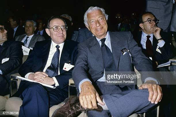 'Italian industrialist and politician Gianni Agnelli president of FIAT smiling with Italian economist and politician Carlo Azeglio Ciampi 1980s '