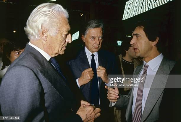Italian industrialist and politician Gianni Agnelli president of FIAT talking with Italian industrialist Vittorio Ghidella at a FIAT plant Turin 1980s