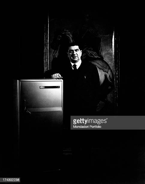 Italian industrialist Giovanni Borghi leaning on a refrigerator made in the factory established by himself Varese 1963