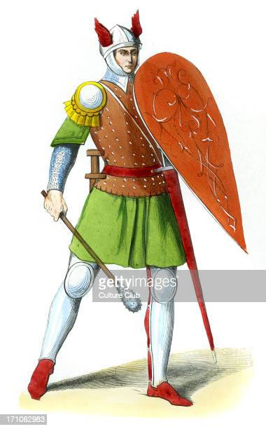 Italian Infantryman in 14th century wearing steel helmet with red wings. Steel armour on his legs and chain mail on his arms. Red shoes. Carries a...