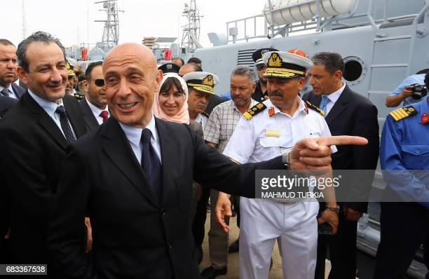 Italian Interior Minister Marco Minniti and Libyan Defence Minister of the UNbacked Government of National Accord AlMahdi AlBarghathi walking in the...