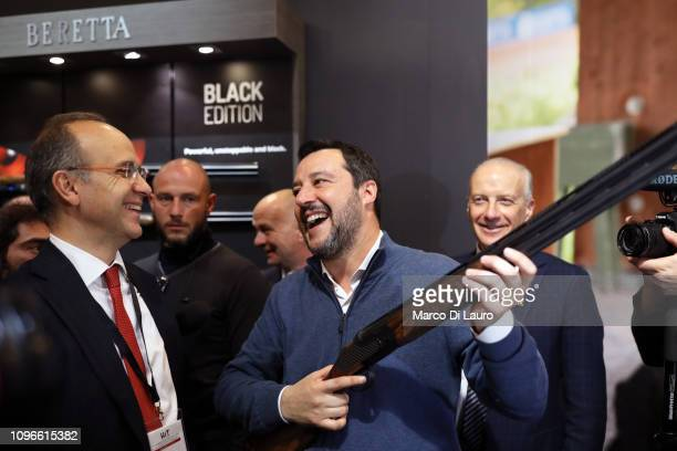 Italian Interior Minister Matteo Salvini is seen holding a Beretta Rifle next to Beretta's Director General Carlo Ferlito at the HIT Trade Show on...