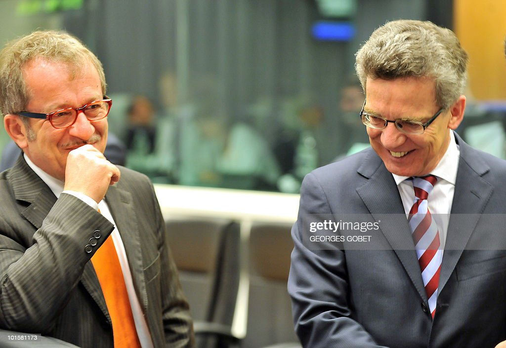 Italian Interior Minister Roberto Maroni (L) talks with his German counterpart Thomas de Maiziere prior to a Justice and Home Affairs council meeting on June 3, 2010 at the EU Council building in Luxembourg.