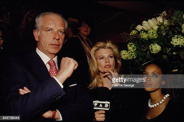 Italian jeweler and luxury goods retailer Paolo Bulgari, Actress Kim Basinger and Brandi on the set of the film Prêt-à-Porter, , directed by American...