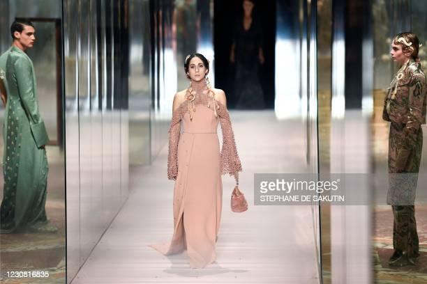 Italian jewelry designer Delfina Delettrez Fendi presents a creation of British designer Kim Jones for the Fendi's Spring-Summer 2021 collection...