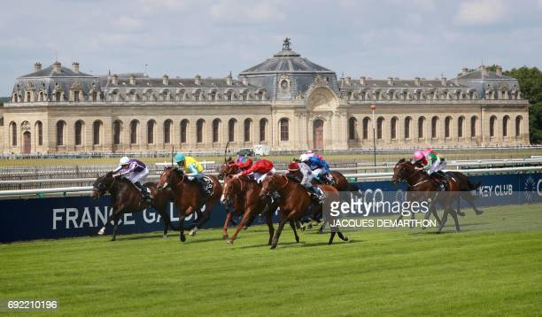 Italian jockey Christian Demuro rides horse Brametot before winning the French Derby horse race on June 4 2017 in front of the stables of Chantilly...