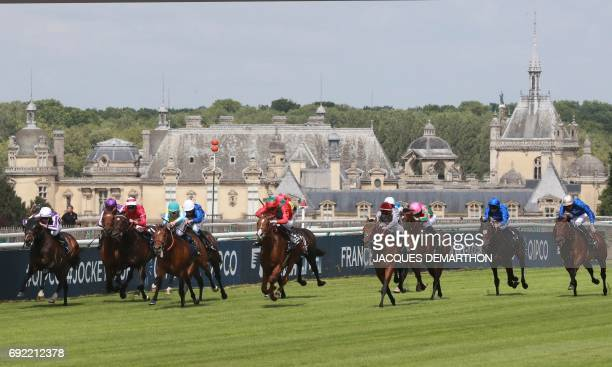 Italian jockey Christian Demuro rides horse Brametot before winning the French Derby horse race on June 4 2017 in front of the Chantilly castle at...