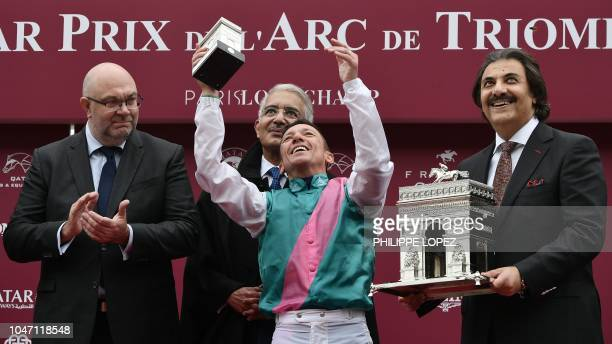 Italian jockey Frankie Dettori flanked by French Agriculture Minister Stephane Travert and Saudi Prince Saud bin Khaled bin Abdul rahman Al Saud...