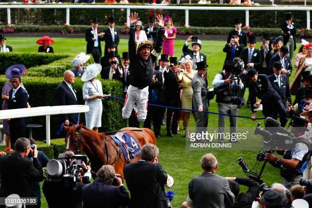 Italian jockey Frankie Dettori jumps off horse Stradivarius after winning the Gold Cup on day three of the Royal Ascot horse racing meet in Ascot...