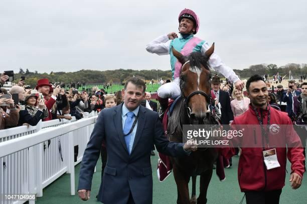 Italian jockey Frankie Dettori on his horse Enable celebrates after winning the 2018 Qatar Prix de l'Arc de Triomphe flat race at the ParisLongchamp...