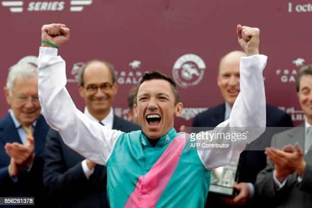 Italian Jockey Lanfranco Dettori aka Frankie Dettori reacts as he celebrates on the podium during the price ceremony after winning the 96th Qatar...