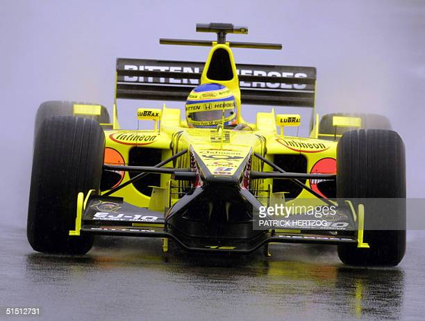Italian JordanHonda driver Jarno Trulli steers his car as rain falls on the Silverstone racetrack 14 July 2001 during the second free practice...