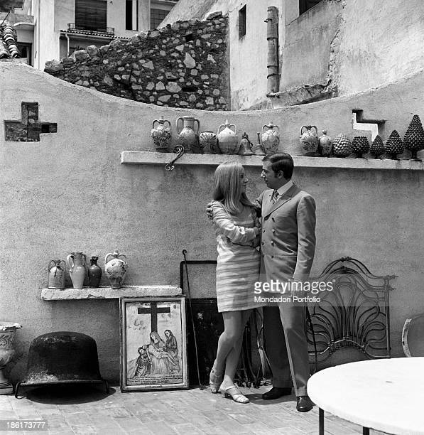 Italian journalist and art director Annarita Torsello fondly looking into the eyes her partner the Italian TV and radio presenter Mike Bongiorno...
