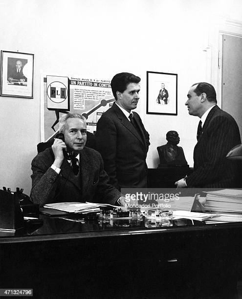 Italian journalist and politician Augusto Premoli giving a call for organizing the electoral campaign of the Italian Liberal Party . Behind him, the...