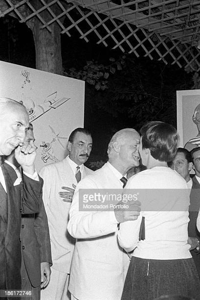 Italian journalist and publisher Alberto Mondadori looking at Italian writer, painter and poet Leonida Repaci greeting Italian writer Natalia...