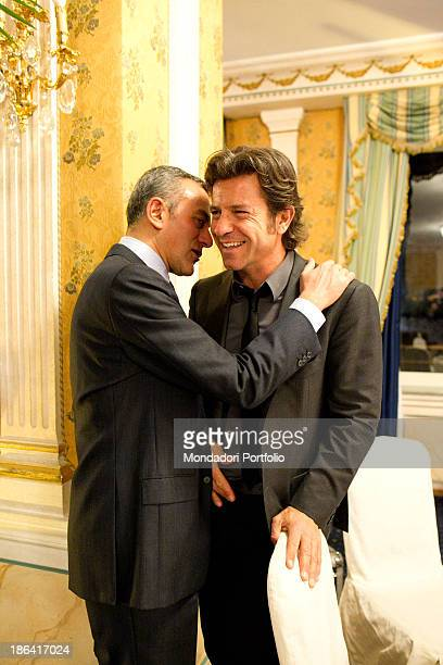 Italian journalist Antonello Sarno whispering into the ear of Italian actor and TV presenter Paolo Conticini during the reception at the hotel Parco...