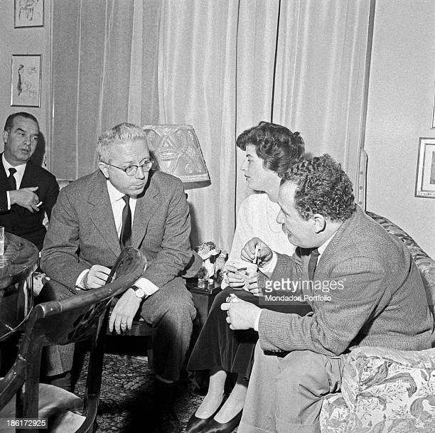 Italian journalist Enzo Biagi Italian writer and translator Mariagloria Sears and Italian writer and actor Giancarlo Fusco attending a party in...