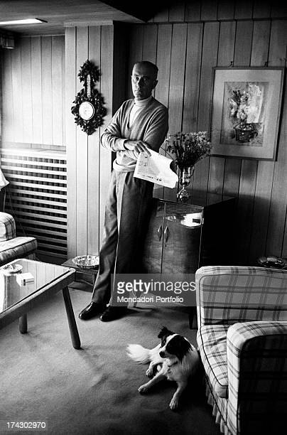 Italian journalist Indro Montanelli posing with a newspaper in his hand 1960s