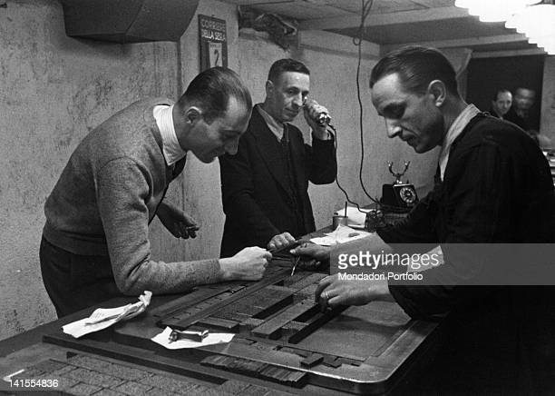 Italian journalist Indro Montanelli watching a man at work in the Corriere della sera printing house 1940s