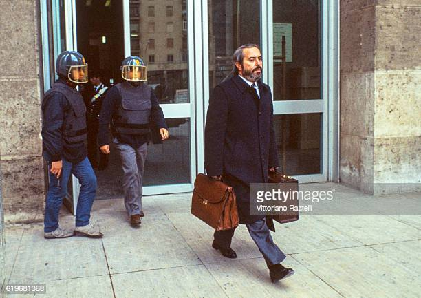 Italian judge Giovanni Falcone is escorted by police out of the Court of Palermo Italy on May 16 1985 Giovanni Falcone was killed by the Mafia in 1992