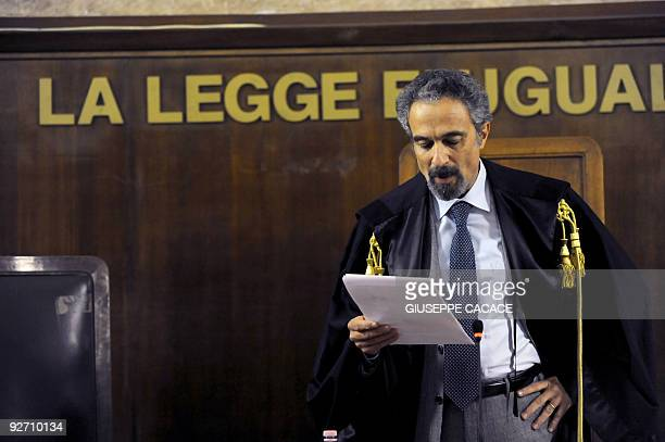Italian judge Oscar Maggi reads on November 4 2009 at a Milan's court the verdict at the end of the trial of 26 US secret agents in the 2003...