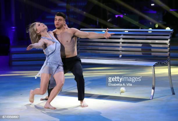 Italian judoka Fabio Basile and his dance partner Anastasia Kuzmina perform on the Italian TV show 'Ballando Con Le Stelle' at Auditorium Rai on...