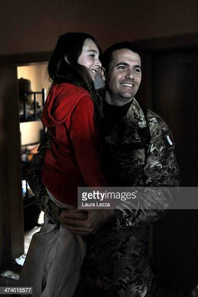 Italian KFOR Captain Gianluca Greco embraces Jovana the young child of a village Serbian leader during a patrolling activiy carried out by Italian...