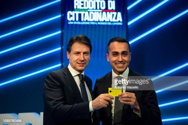 Italian Labor Minister Luigi Di Maio and Italian Prime Minister Giuseppe Conte attend a meeting organized by 5star Movement to present new budget...