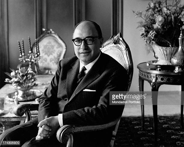 Italian lawyer and Christian Democrat deputy Danilo De' Cocci photographed beside a pendulum-clock. 1963.