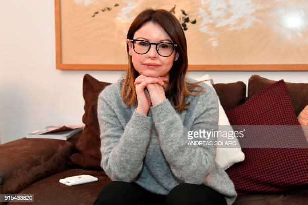 Italian lawyer Lucia Annibali current candidate for Italy's Democratic Party for the upcoming March general elections in the Piedmont region poses...