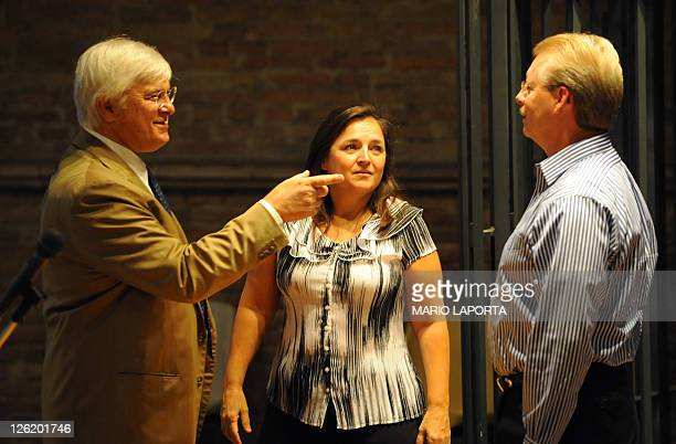 Italian lawyer Luciano Ghirga speaks to the parents of US student Amanda Knox Hedda Mellas and Curt Knox before the trial against Amanda Knox and...