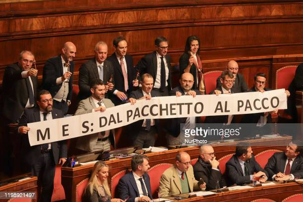 Italian 'League' Senator raise a banner in protest during the Question Time at the Senate Chamber on February 07 2020 in Rome Italy