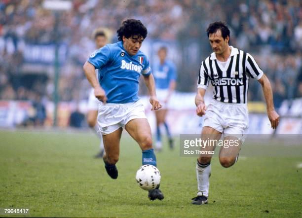 17th April 1988 Juventus 3 v Naples 1 Napoli's Diego Maradona in a race for the ball with Luigi De Agostini of JuventusDiego Maradona won 91...