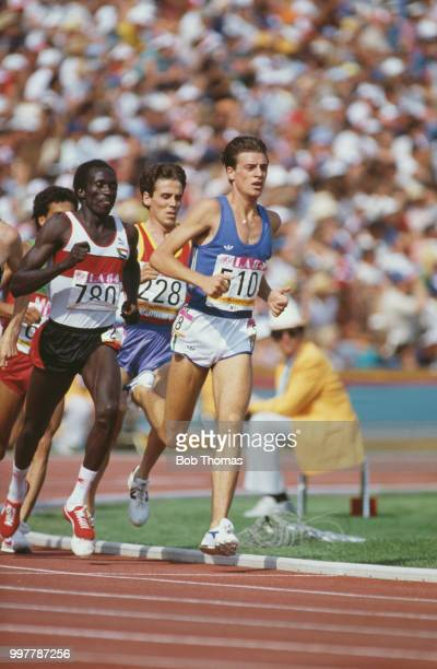 Italian long distance runner Stefano Mei of the Italy team leads Omer Khalifa of Sudan and Jose Luis Gonzalez of Spain in heat 1 of the qualifying...