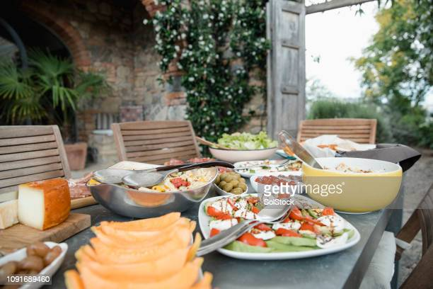 italian lunch at the villa - mediterranean culture stock pictures, royalty-free photos & images