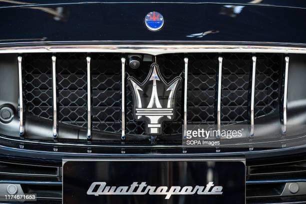 Italian luxury vehicle manufacturer, Maserati logo seen on a Quattroporte sedan in Shanghai Pudong International Airport.