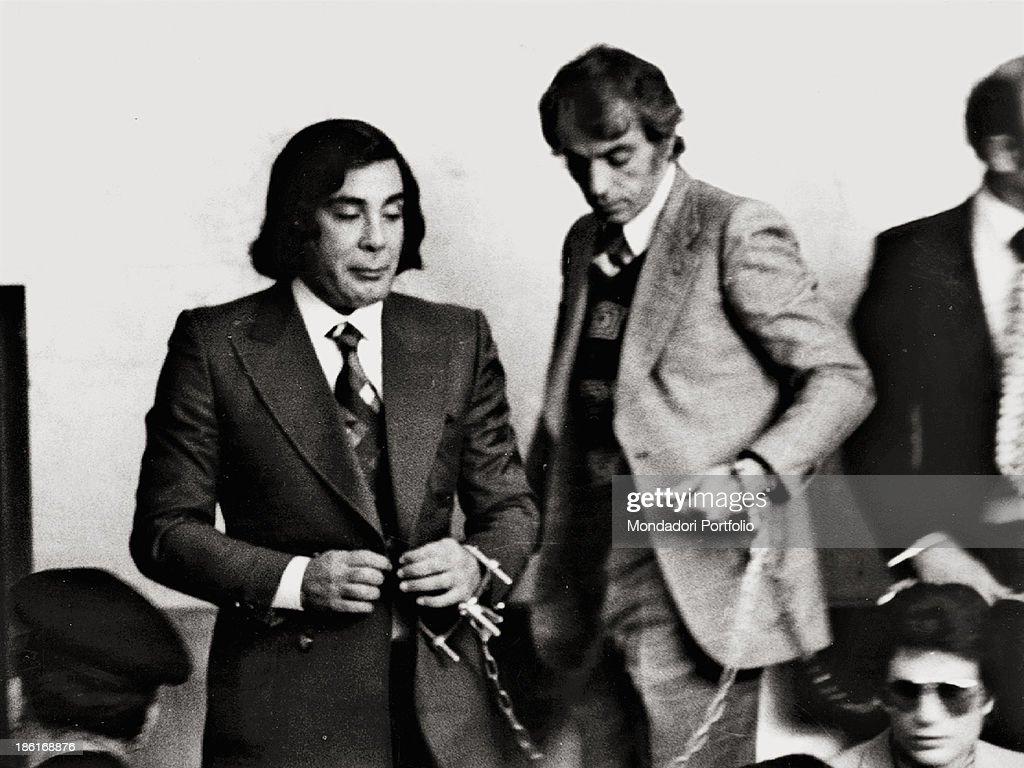 Tommaso Buscetta in handcuffs : News Photo