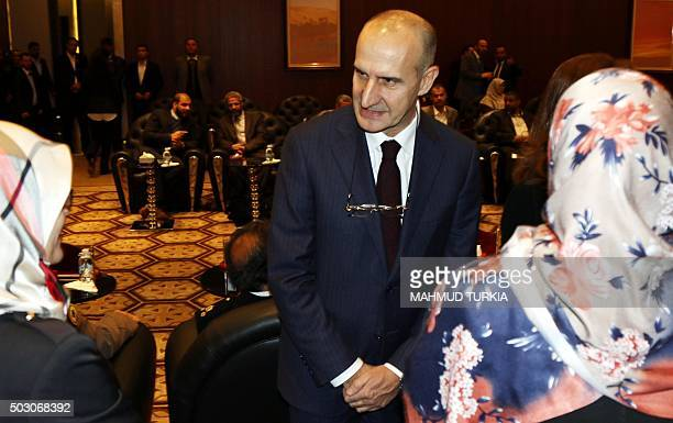 Italian Major General Paolo Serra speaks with members of Libya's General National Congress at the National Conference Hall in the Libyan capital...