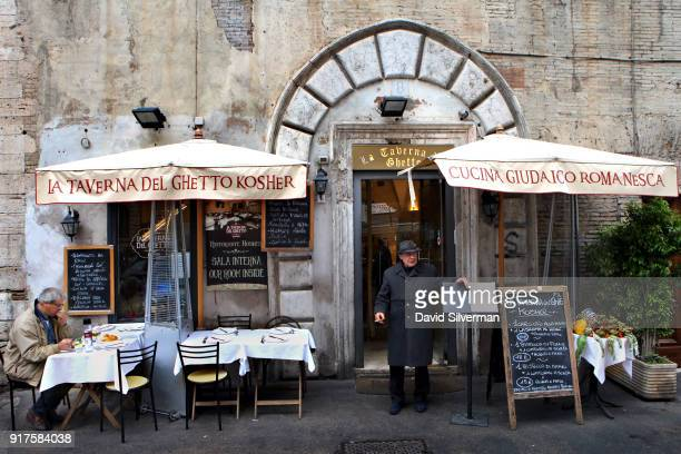 Italian man waits to entice tourists to eat at the La Taverna Del Ghetto kosher restaurant in the Jewish Ghetto on December 11 in Rome Italy The...