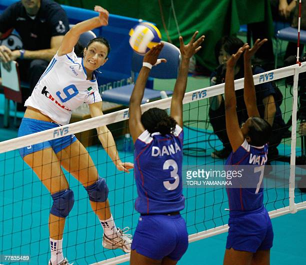 Italian Manuela Secole spikes the ball over the block of Kenyan Diana Khisa and Janet Wanja during the third round match of the FIVB Women's World...