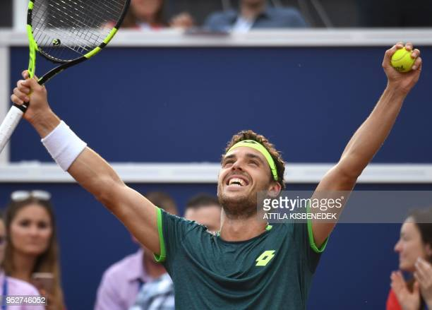 Italian Marco Cecchinato celebrates his victory over Australian John Millman at the end of their ATP final tennis match at the Hungarian Open in...