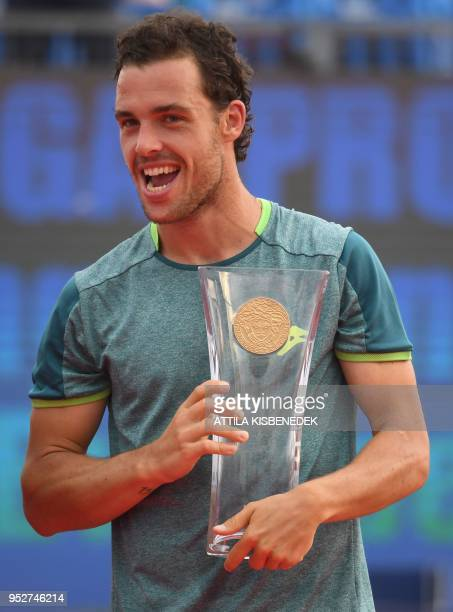 Italian Marco Cecchinato poses with the trophy after his victory over Australian John Millman at the end of their ATP final tennis match at the...