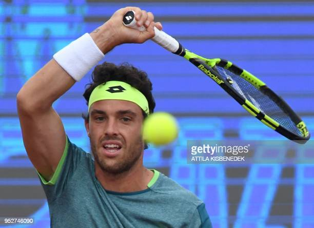 Italian Marco Cecchinato returns the ball to Australian John Millman during heir ATP final tennis match at the Hungarian Open in Budapest on April 29...