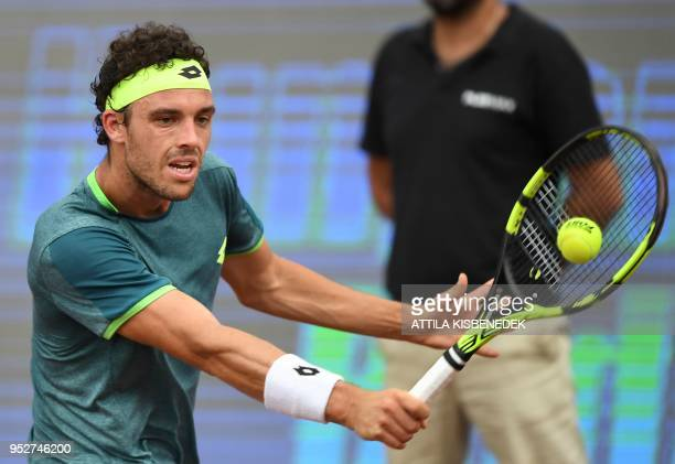Italian Marco Cecchinato returns the ball to Australian John Millman during their ATP final tennis match at the Hungarian Open in Budapest on April...