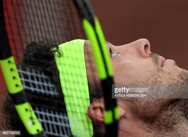 Italian Marco Cecchinato serves to Australian John Millman during their ATP final tennis match at the Hungarian Open in Budapest on April 29 2018