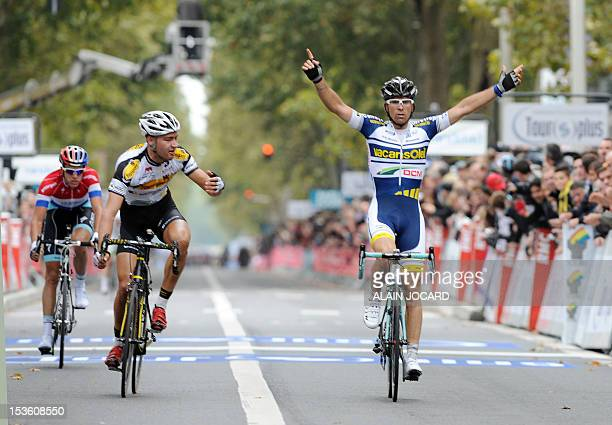 Italian Marco Marcato raises his arms in victory as he crosses the finish line of 106 th edition of the ParisTours cycling race on October 7 2012 in...