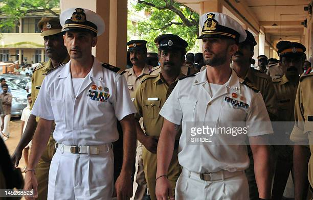 Italian marines Latore Massimiliano and Salvatore Girone are escorted by Indian police outside a court in Kollam on May 25 2012 The two Italian...